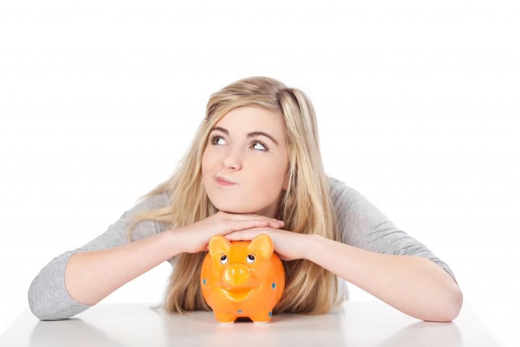 woman holding her piggybank