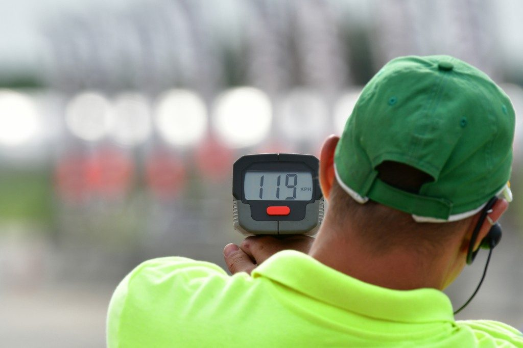 Man using a radar gun