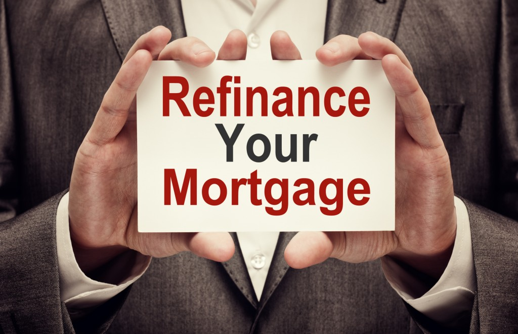 Refinance Your Mortgage card in male hands