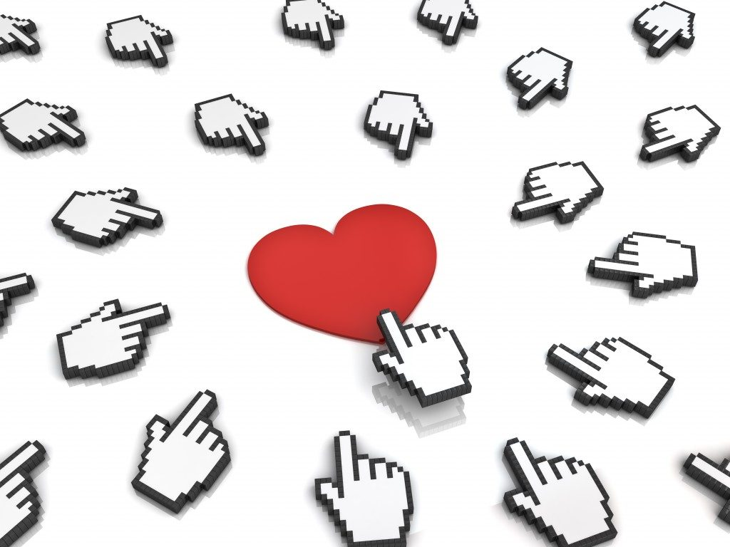 Many hand cursors mouse clicking red heart button