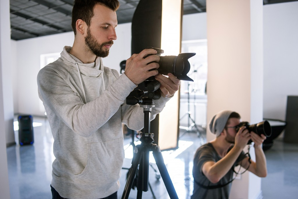 two photographers in a studio