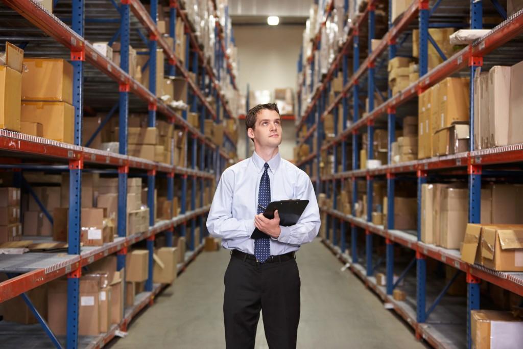 man monitoring the warehouse