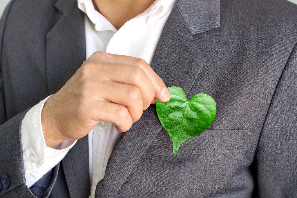man holding a leaf shaped like a heart
