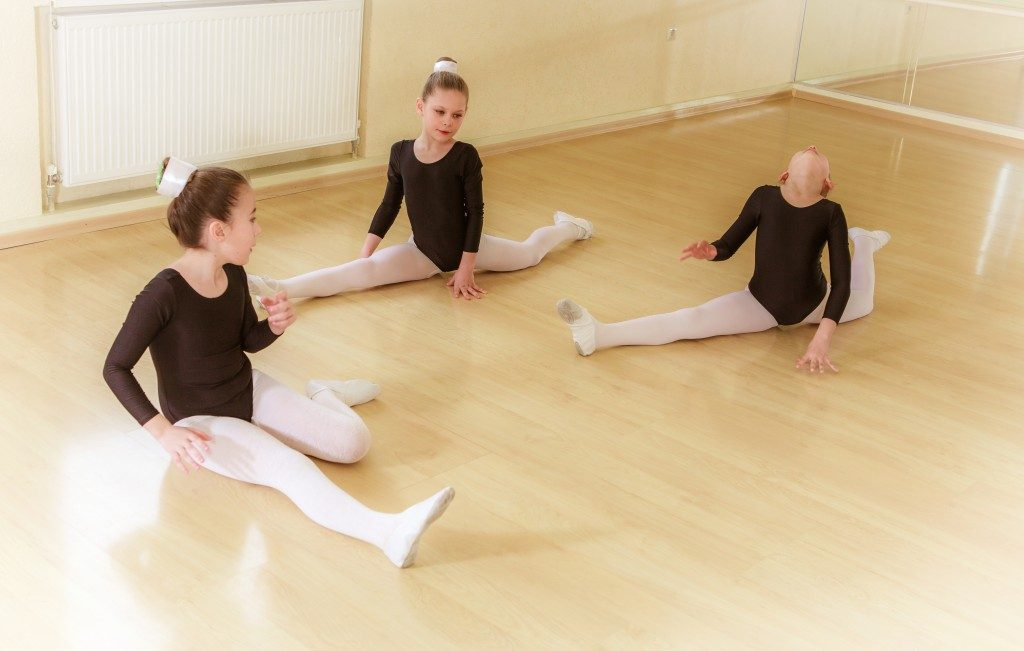 little girls stretching in a dance studio
