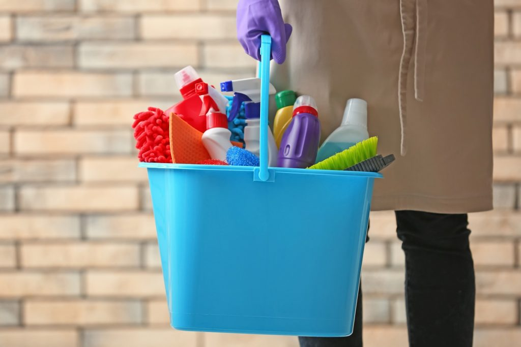 peson holding cleaning materials
