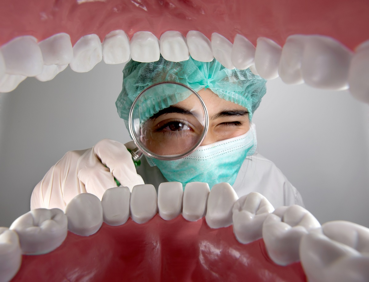 dentist looking into patient's mouth