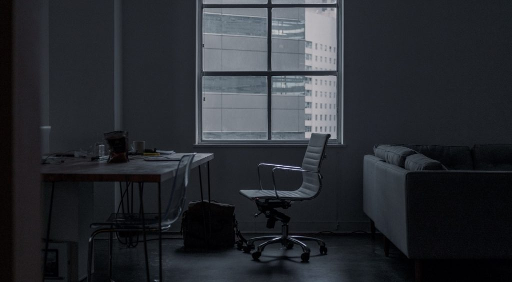 Dark room with white furnitures