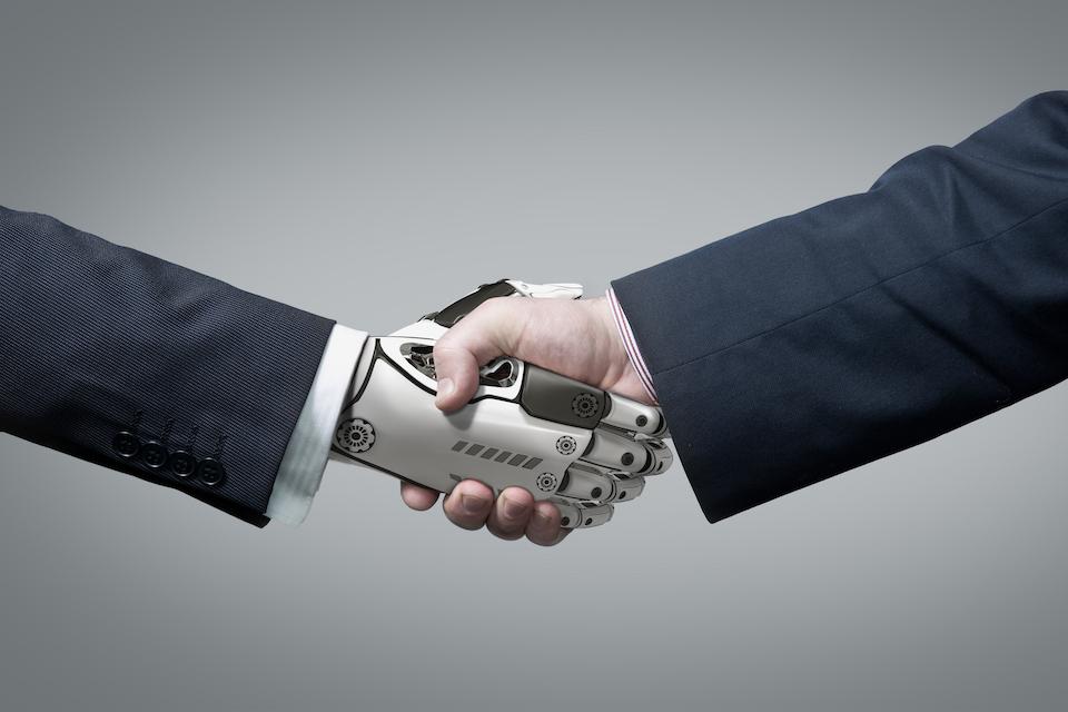 Hand shake of robot and businessman