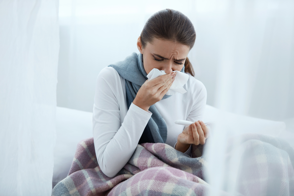 woman feeling sick at home