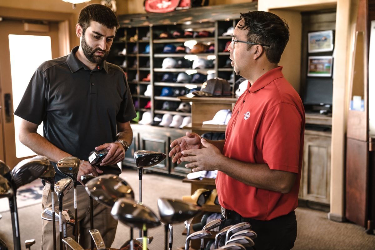 man selling golf equipment