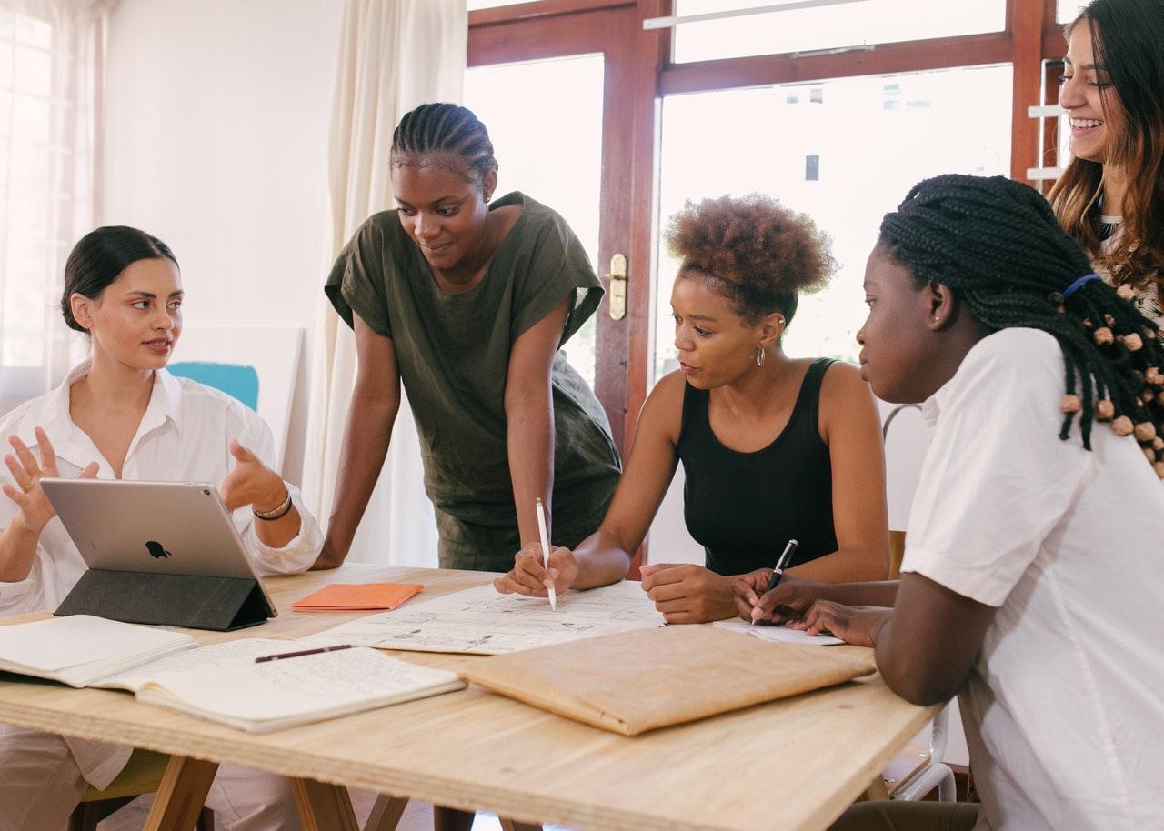 women discussing ideas