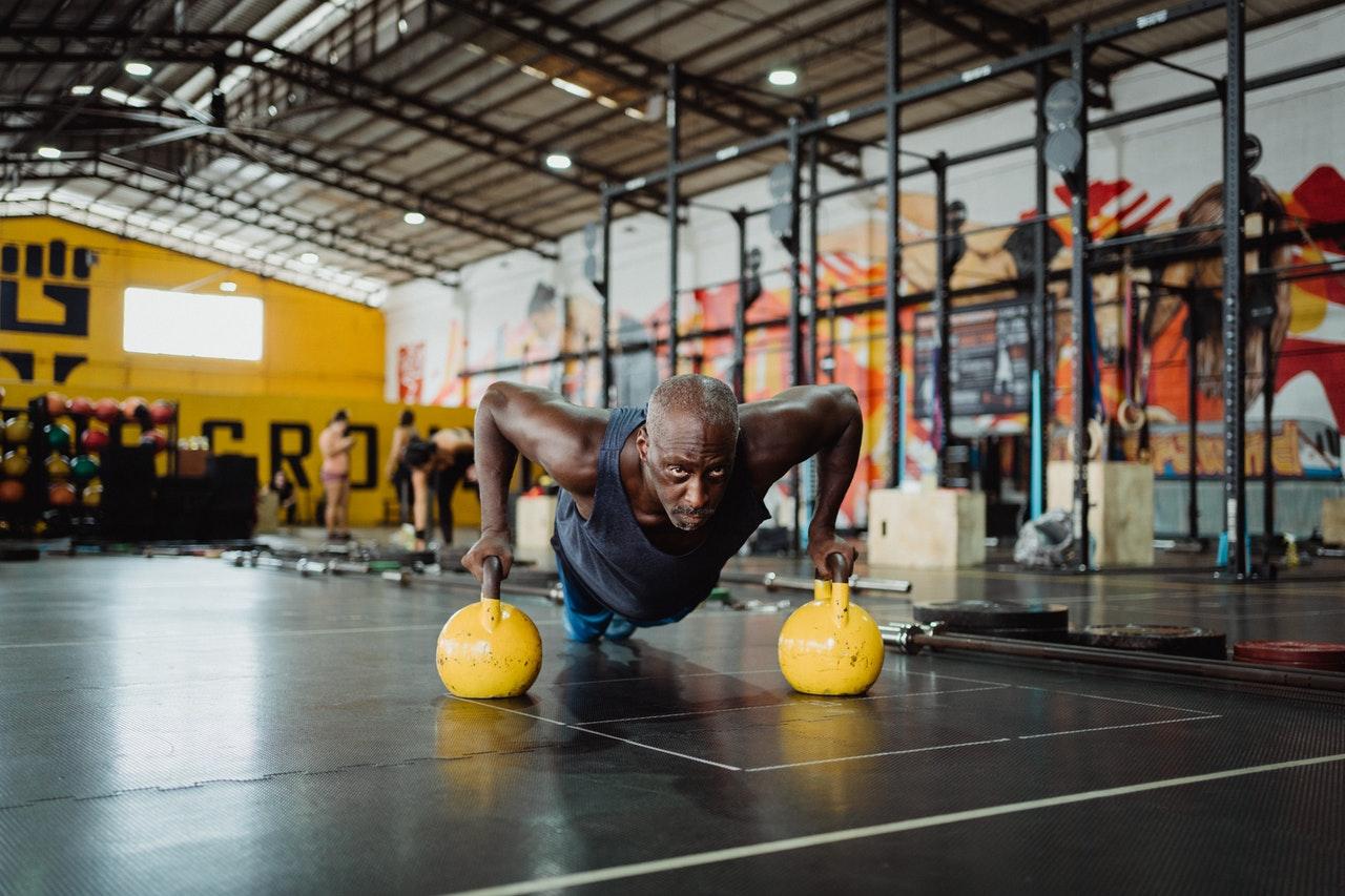 man doing pushups on medicine balls